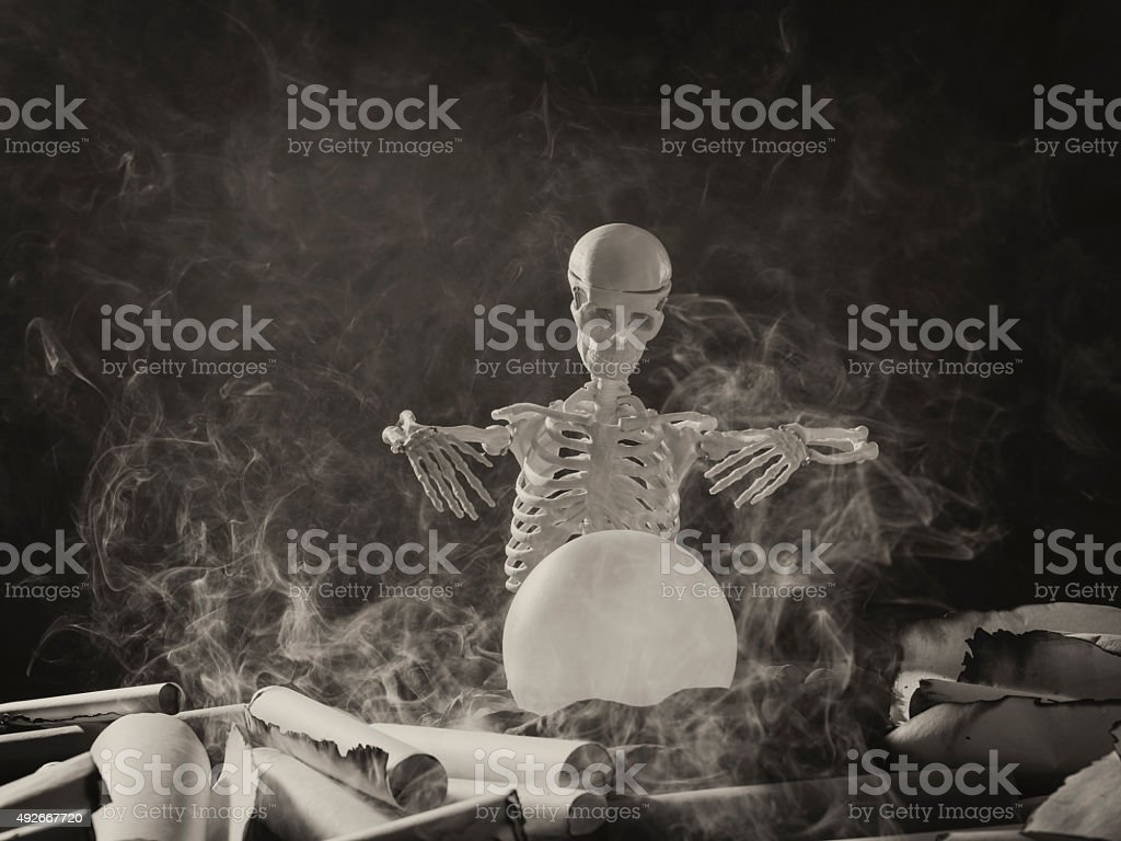 The angel of death looking at the magical sphere stock photo