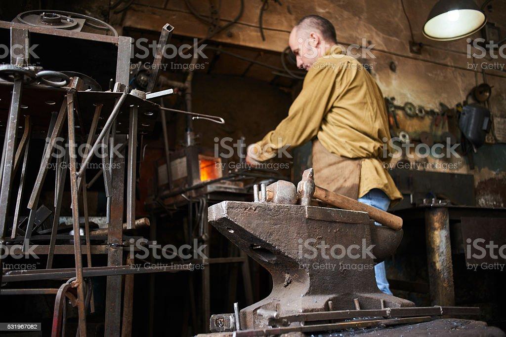 The anvil in the blacksmith shop stock photo
