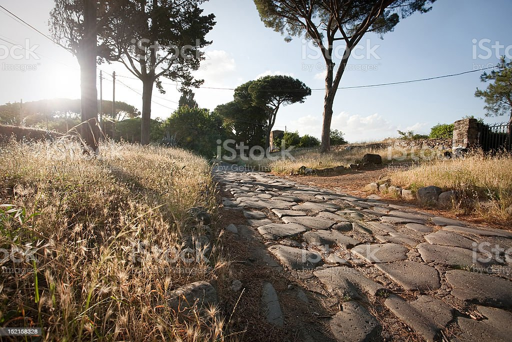 The Appian way in Rome at sunset stock photo