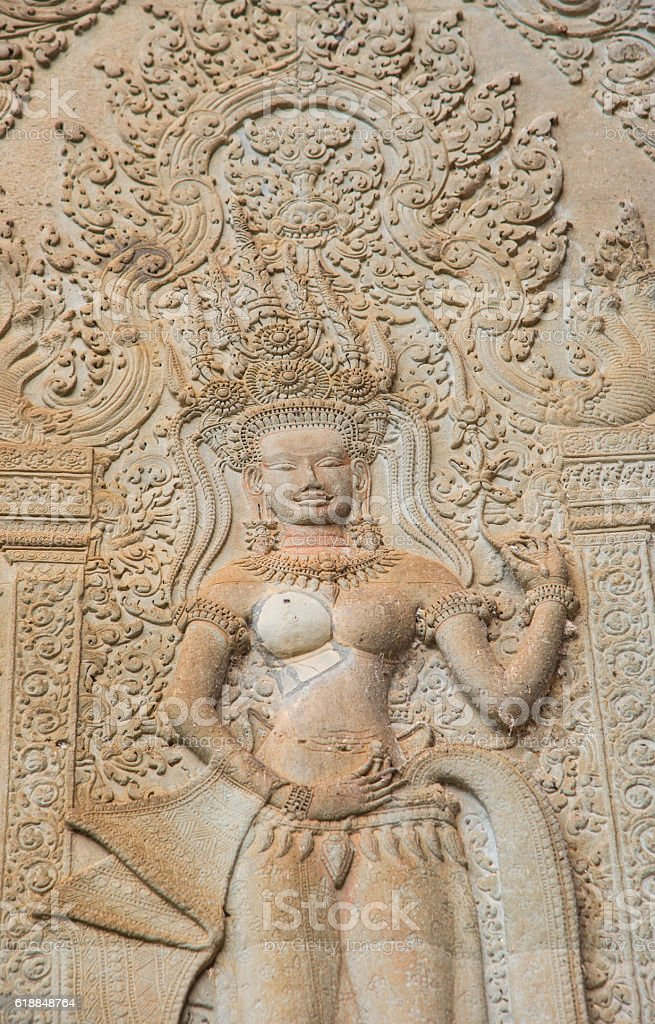 The Apsara stone sculpture in the corner of Angkor Wat. stock photo