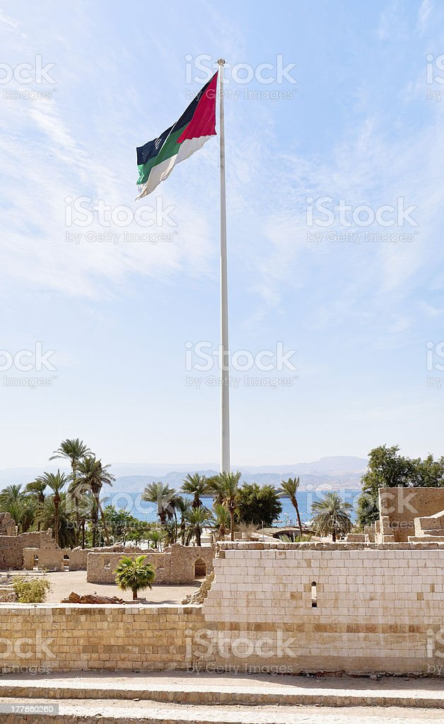 The Aqaba Flagpole under ruins of medieval Mamluks fort stock photo