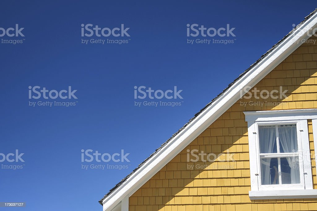 The architectural detail of a roofline on a home stock photo