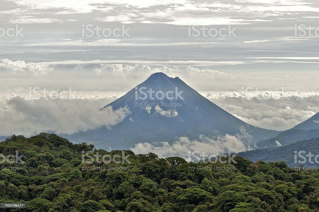 The Arenal Volcano between layers of cloud stock photo