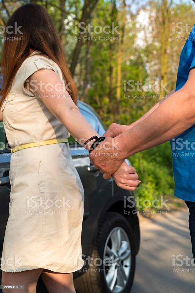 the arrest of a young woman stock photo