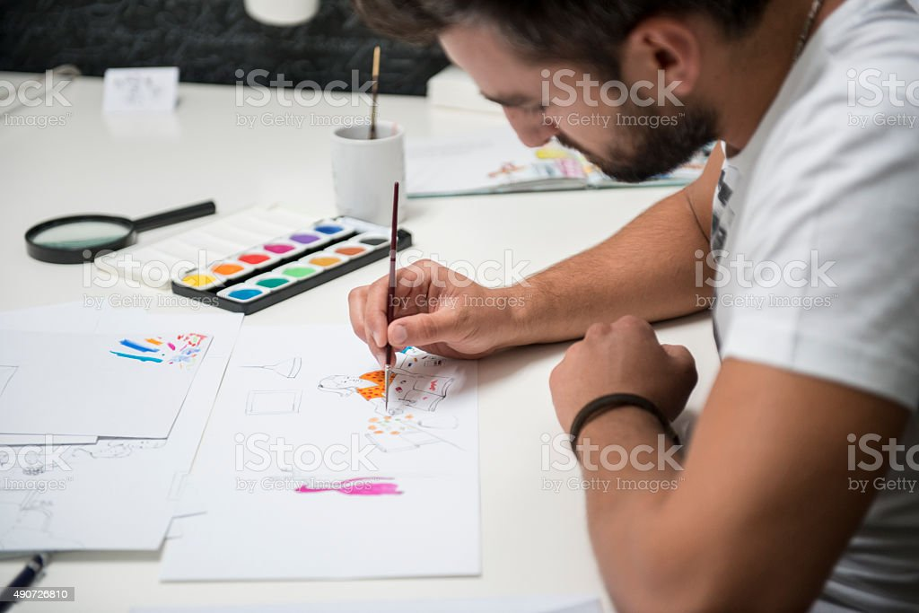 the artist makes sketches stock photo