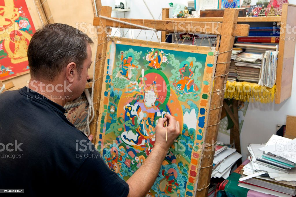 The artist paints a Buddhist icon stock photo