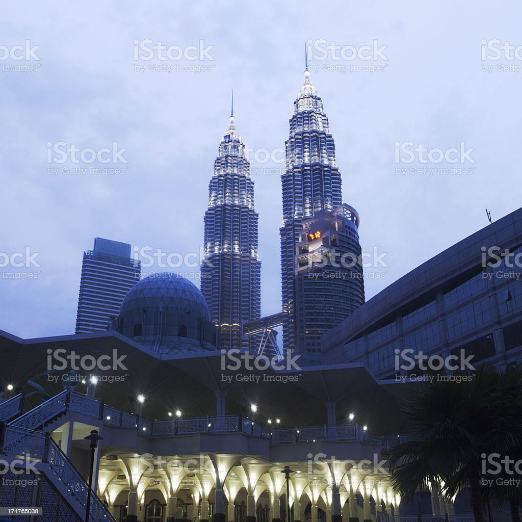 The As Syakirin Mosque in KlCC and Petronas towers. royalty-free stock photo