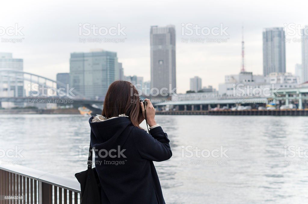 The Asian female with the camera stock photo