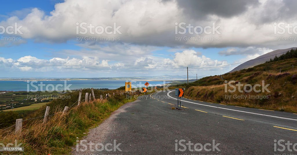 The asphalt road with signs in sunny day stock photo