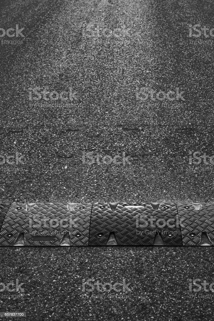 the asphalted road and hump closeup stock photo