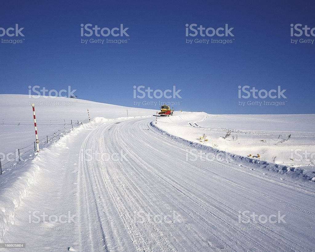 The asphalted road covered with snow royalty-free stock photo