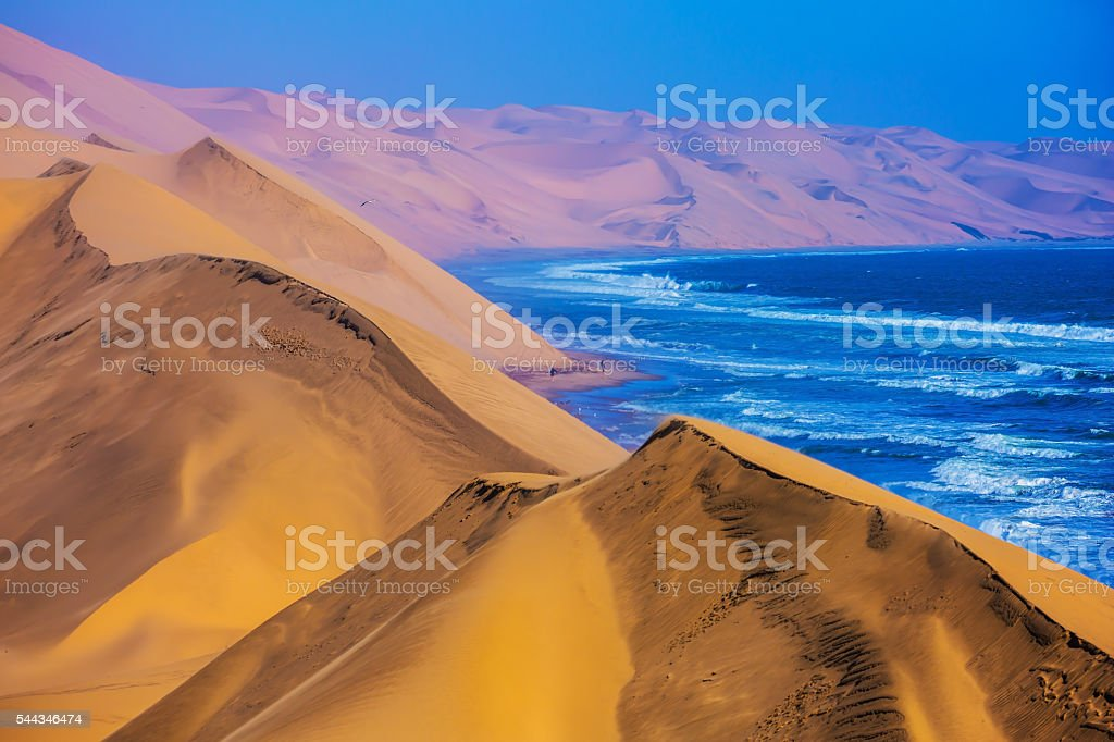 The Atlantic Ocean,  moving sand dunes, Namibia stock photo