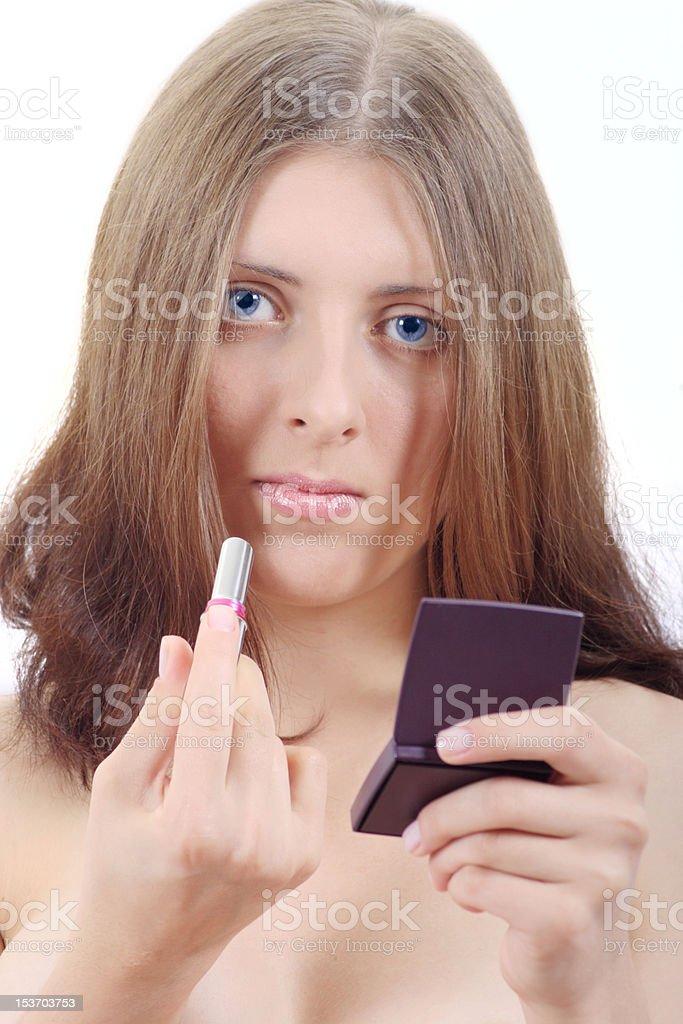 Atrakcyjna Dziewczyna z szminki i lusterko zbiór zdjęć royalty-free