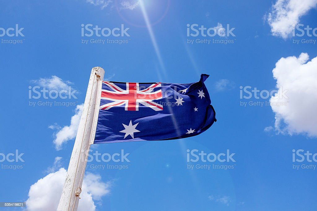 The Australian national flag waving in the wind stock photo