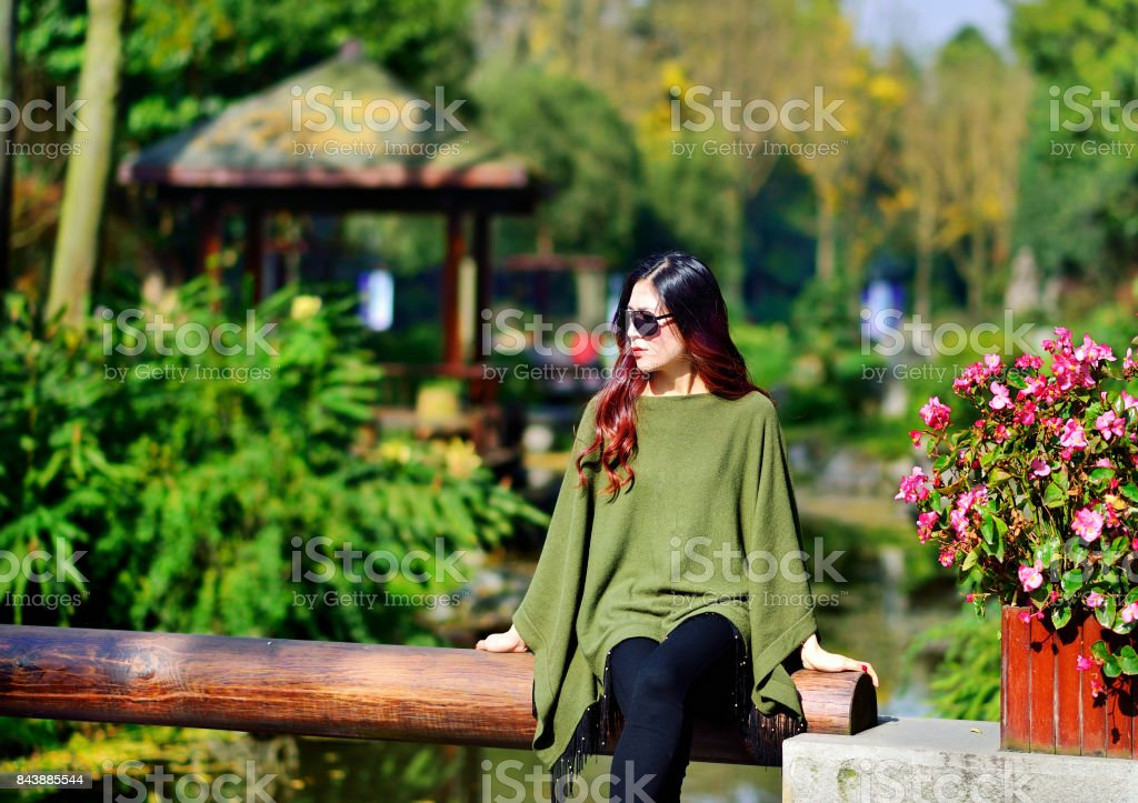 The autumn, the women wear sunglasses in the garden stock photo