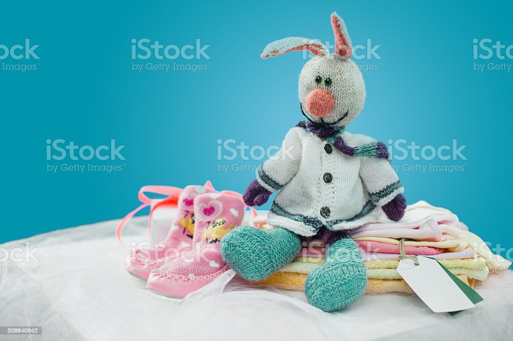 The baby clothes with card stock photo