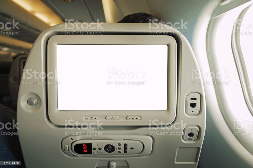 The back of a modern airplane seat with TV screen and more royalty-free stock photo