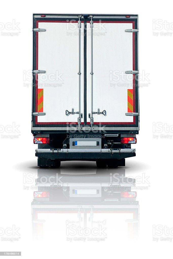 The back of a truck trailer on a white reflective background stock photo