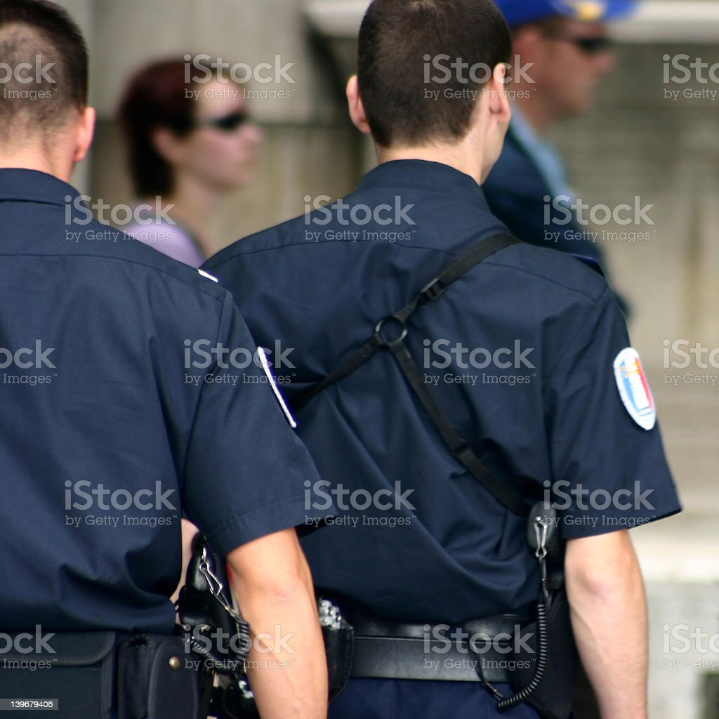 The back of two police officers stock photo