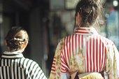 The back of two young women wearing Kimono