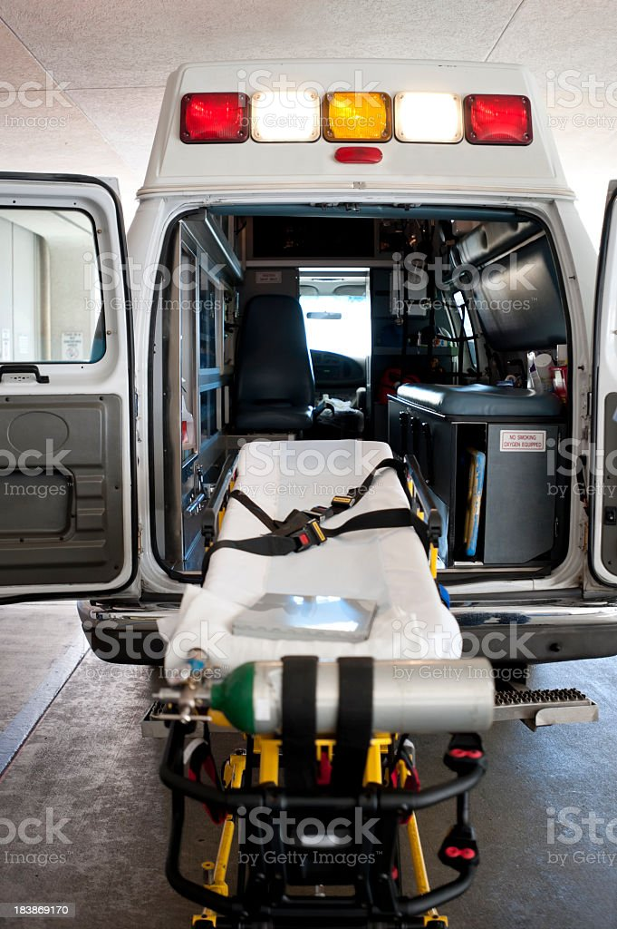 The back on an ambulance with a gurney for patient transport royalty-free stock photo