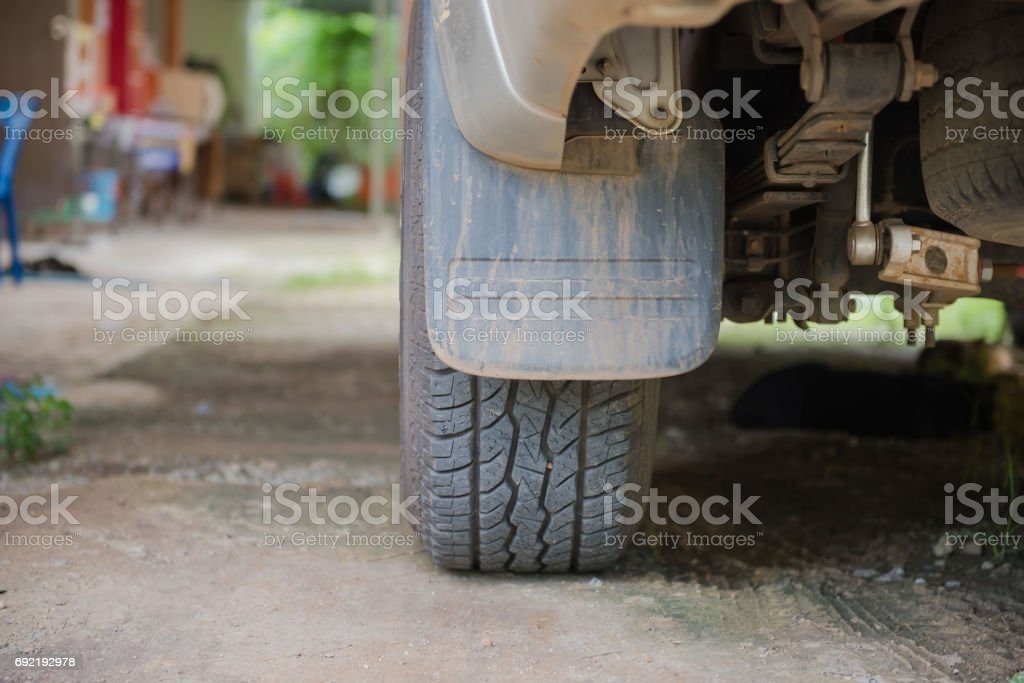 The back tire of cars parked on grass stock photo