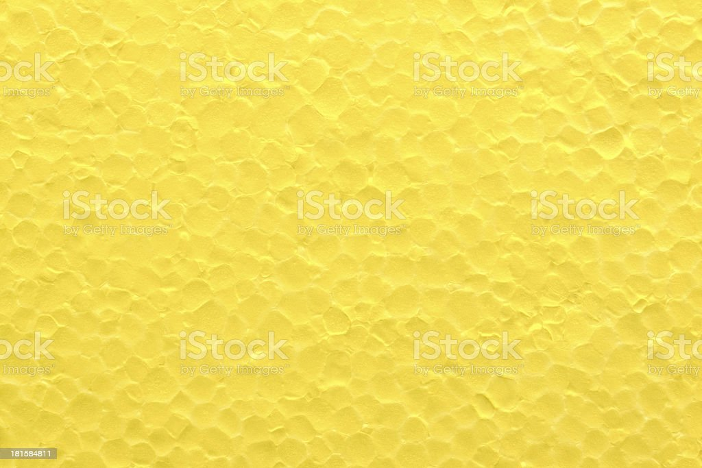 The background from bright yellow styrofoam royalty-free stock photo