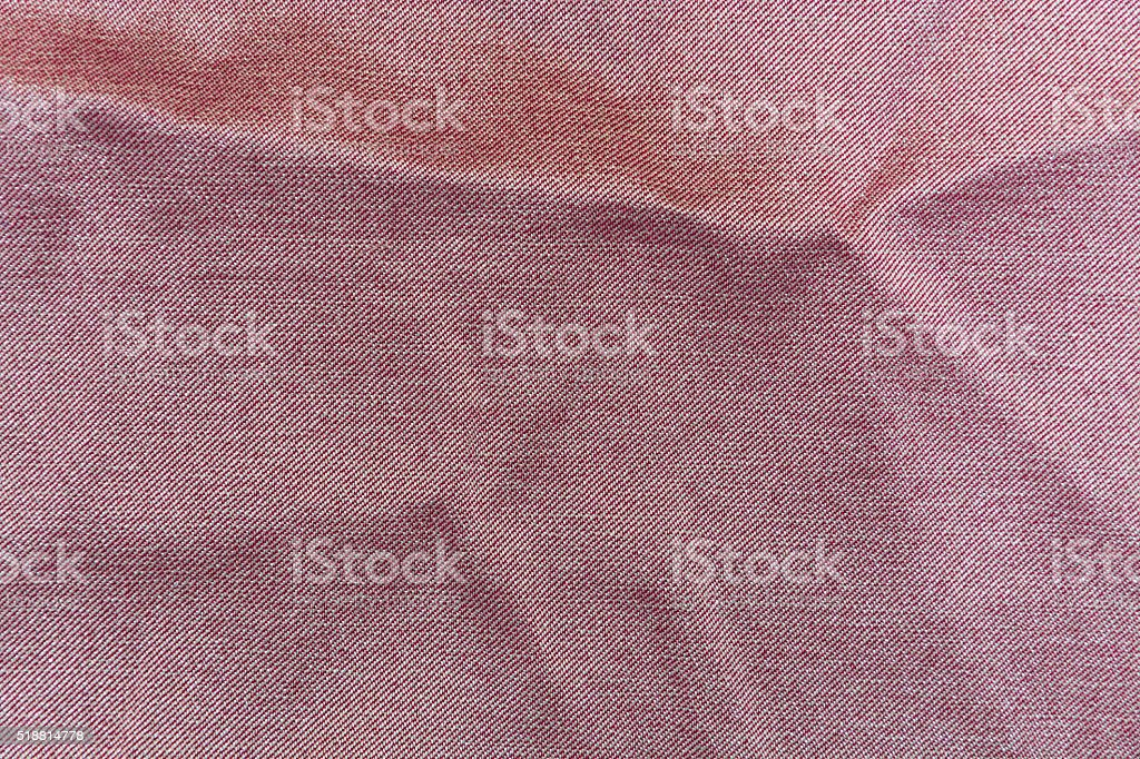 The background of light red denim stock photo