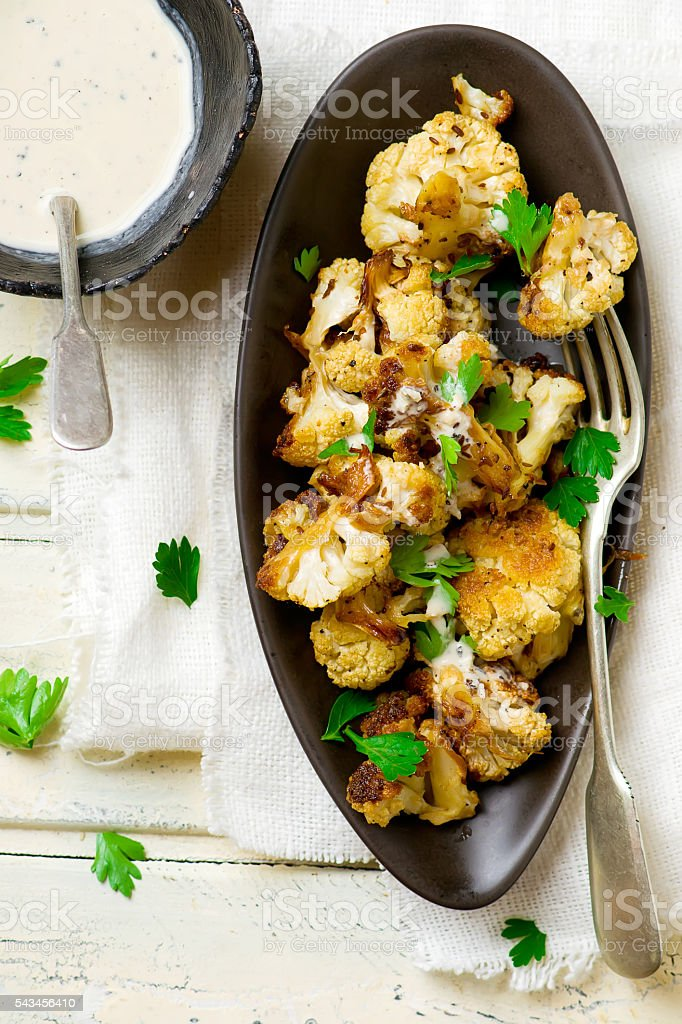 the baked cauliflower with sauce. stock photo