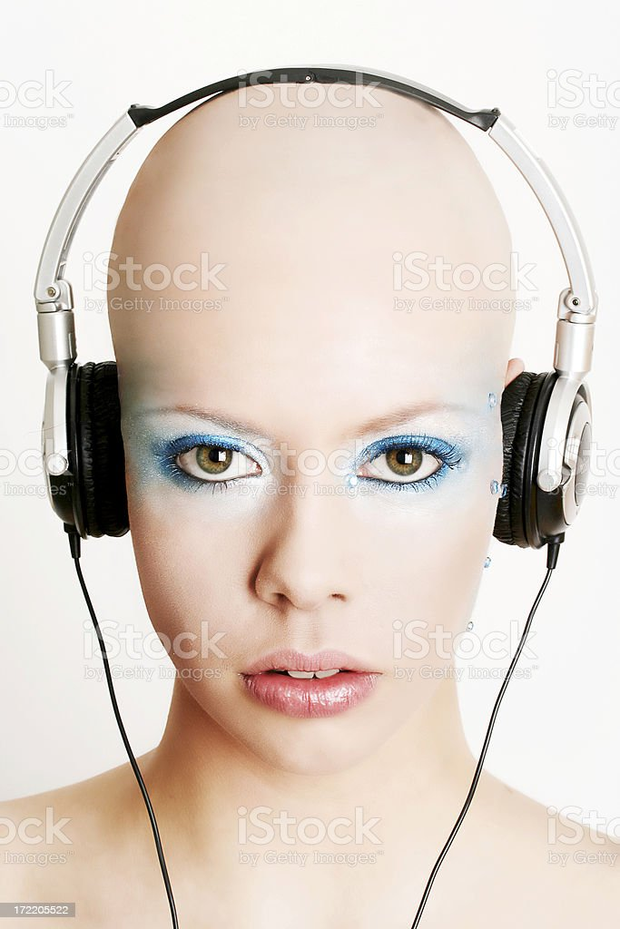 The Bald beauty with headphones royalty-free stock photo