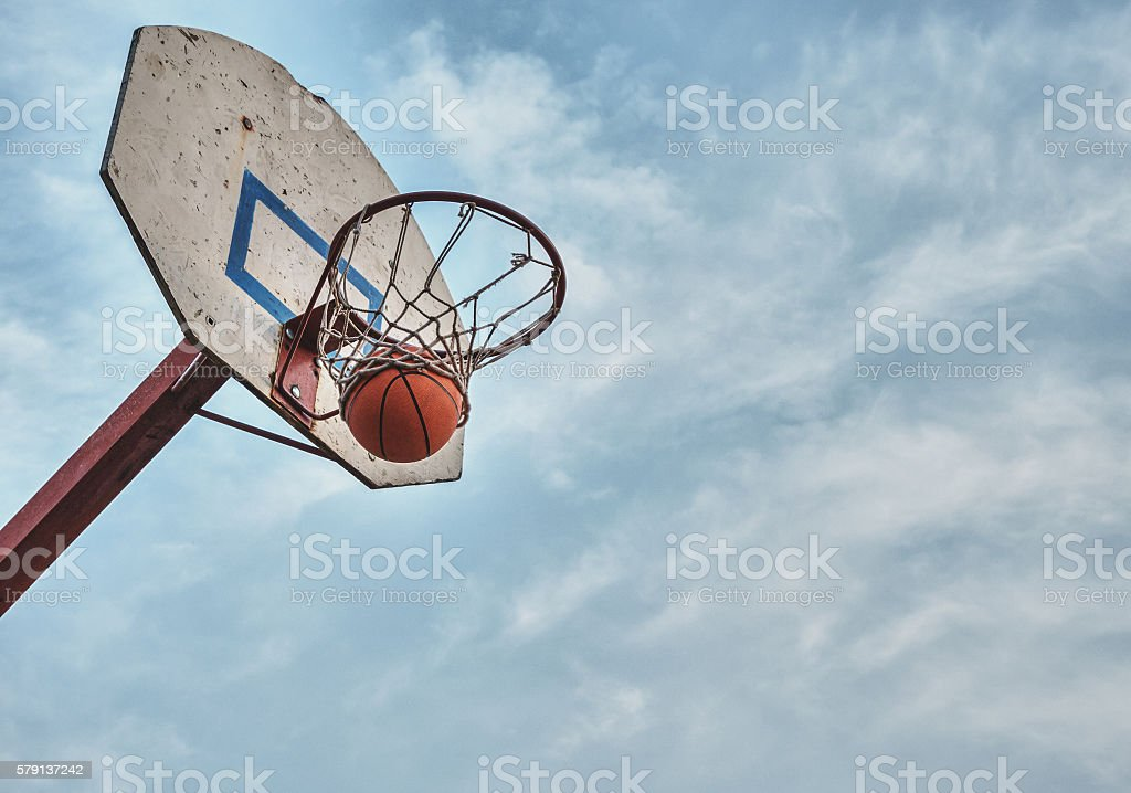 The ball flew into the basket. stock photo