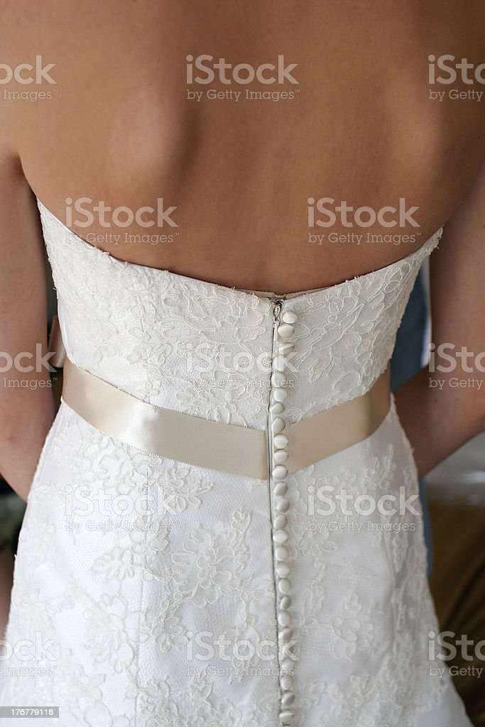 The bck of a beautiful white wedding dress stock photo