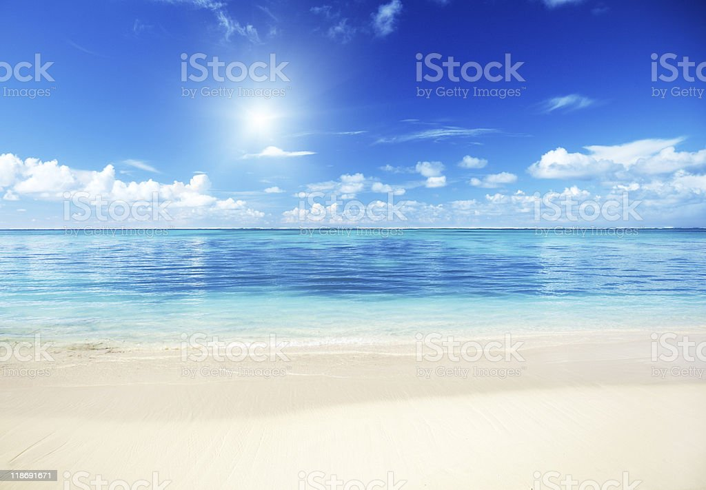 The beach and sand of the Caribbean sea stock photo