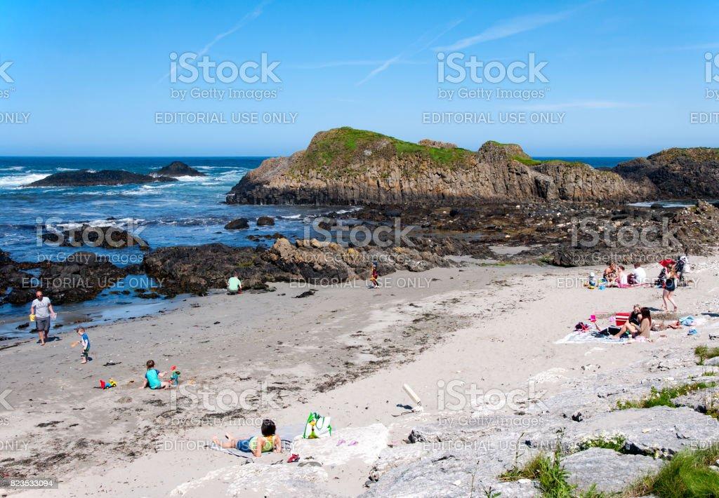 The beach at Ballintoy harbor, Northern Ireland stock photo