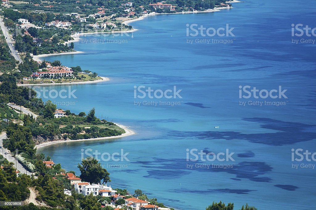 The beach front of a small town with clear blue sea stock photo