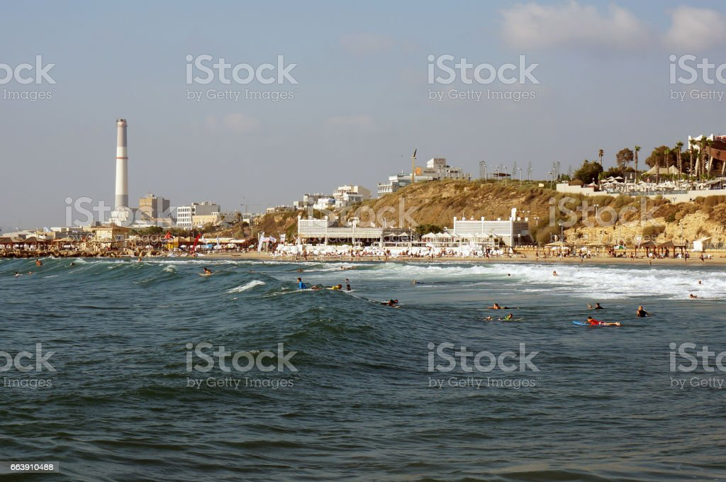 The beach is against the background of Israel's industry. stock photo