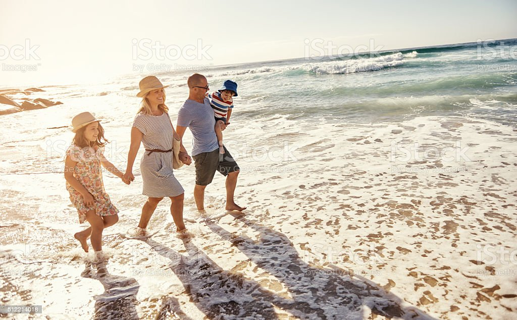 The beach is the best spot for a family outing stock photo