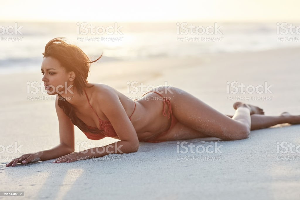 The beach only adds to my sexiness stock photo