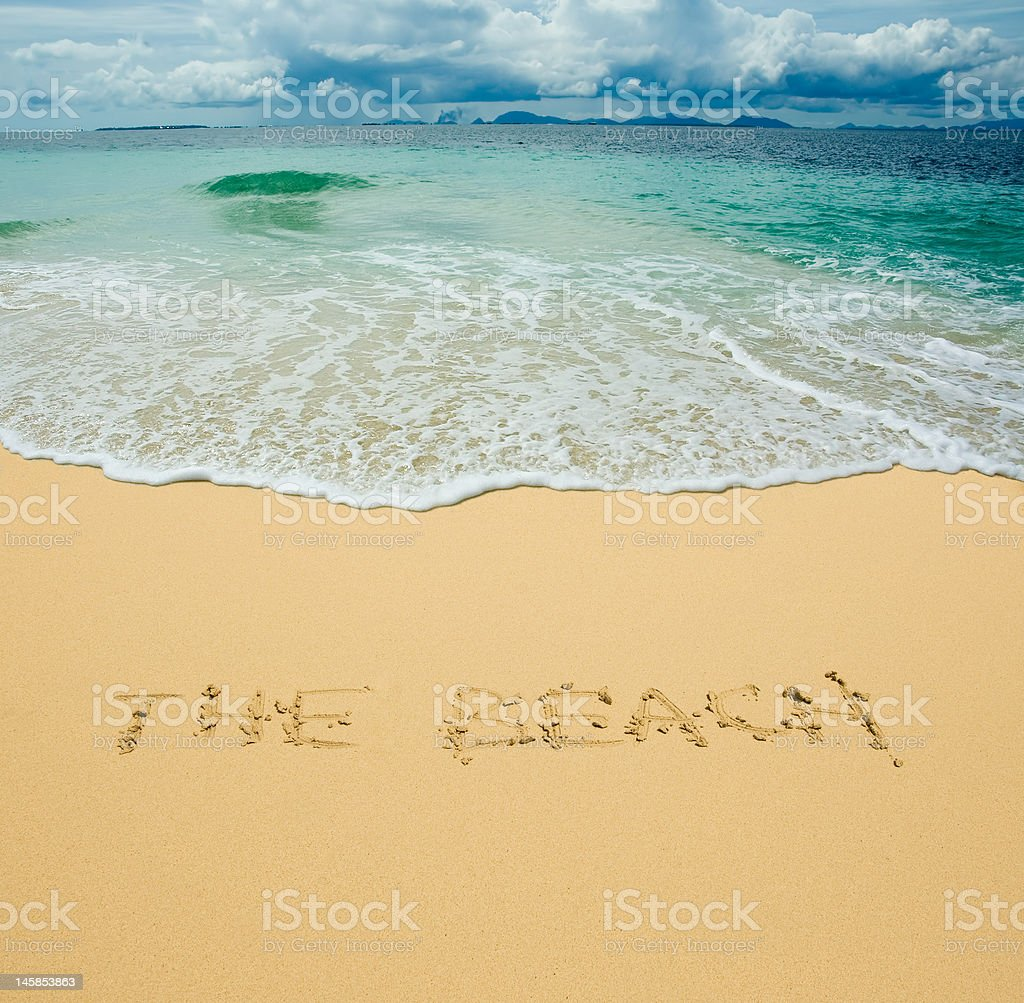 the beach written in a sand royalty-free stock photo