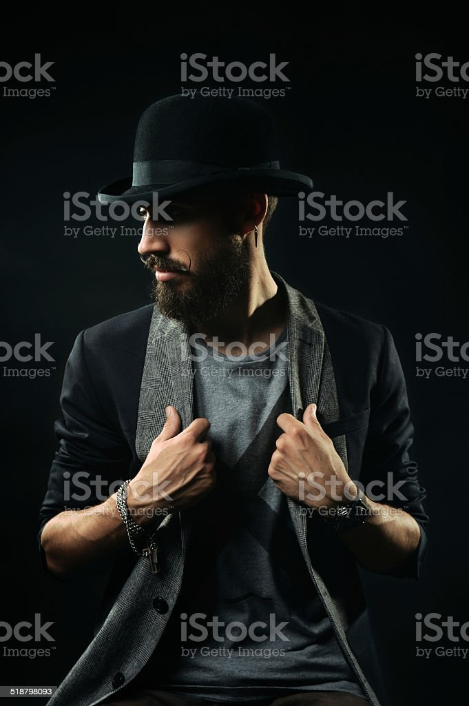 The bearded man in a bowler hat stock photo