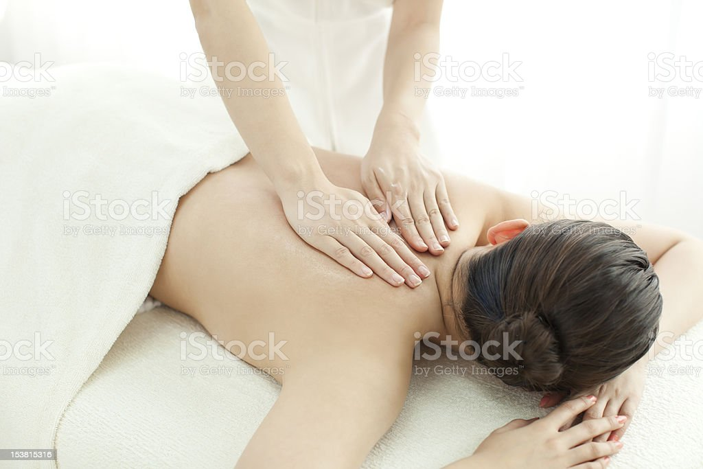 The beautician who massages a back royalty-free stock photo