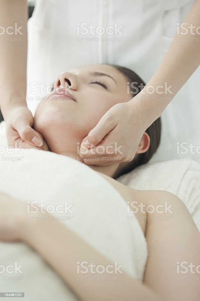 The beautician who massages a face royalty-free stock photo