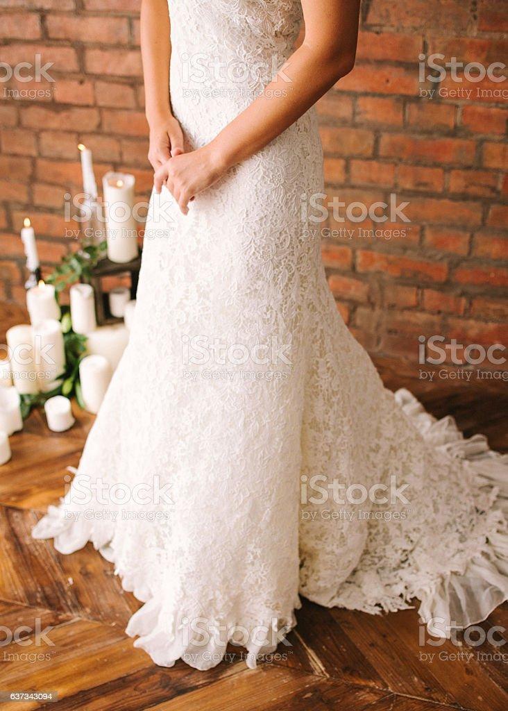the beautiful bride in a white guipure elegant dress. stock photo