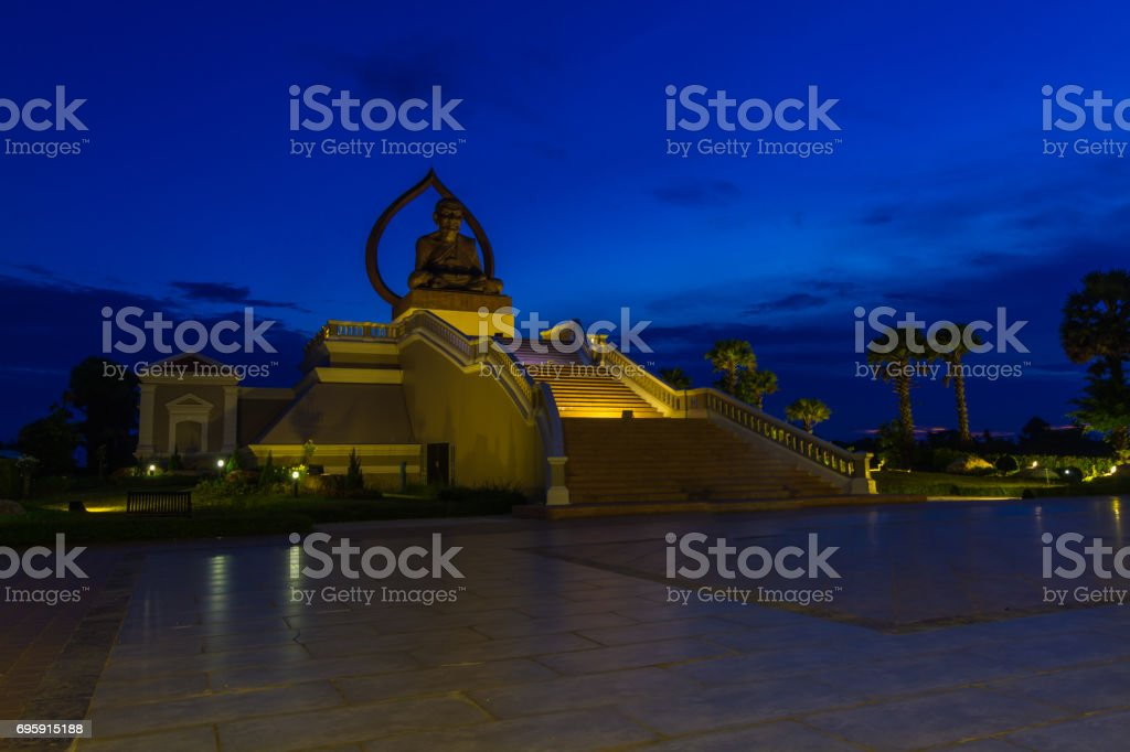 The beautiful Buddha sits in the courtyard of the temple in the beautiful sky. stock photo