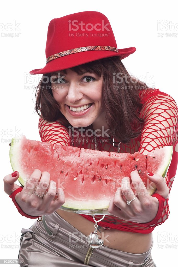 The beautiful girl eats a water-melon royalty-free stock photo