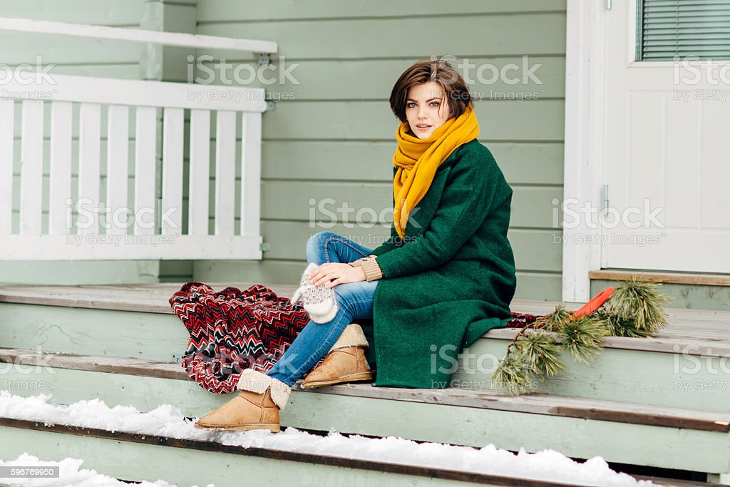 the beautiful girl in warm clothes stock photo