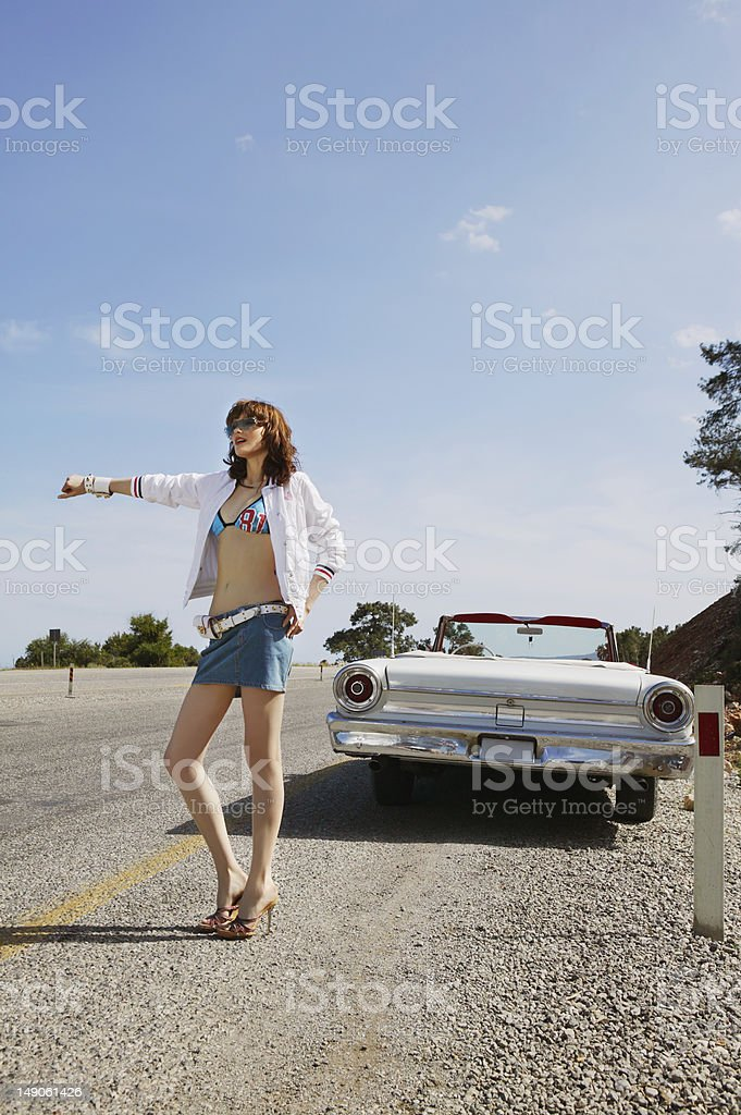 The beautiful girl on highway royalty-free stock photo