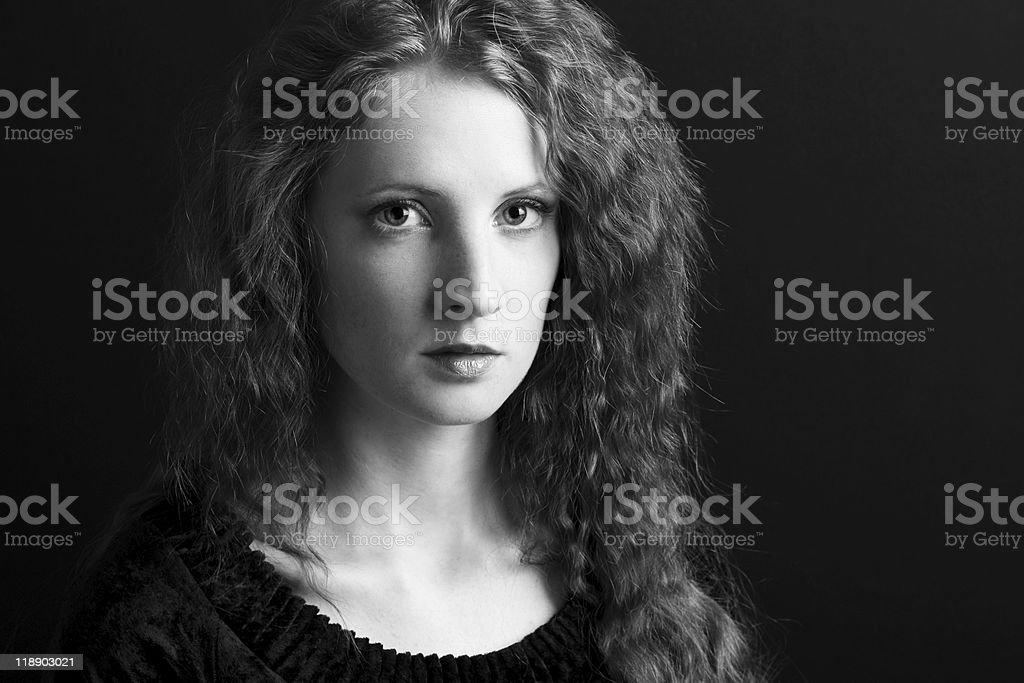 The beautiful girl with curly hair stock photo