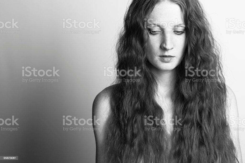 The beautiful girl with curly hair royalty-free stock photo