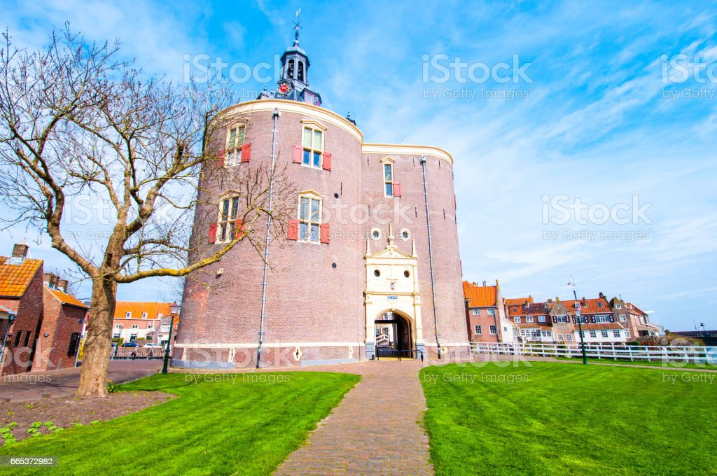 The beautiful historic city of Enkhuizen in North Holland with the unique monument Drommedaris. Drommedaris is a historic gate in Enkhuizen, It was built starting in 1540. stock photo
